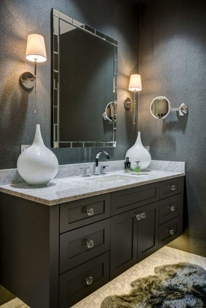 The marble master bath has a lighted makeup mirror with a high-tech motion sensor that turns as someone approaches.