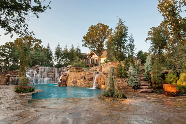 Kelly Caviness of Caviness Landscape Design says waterfalls are both attractive and therapeutic. Photo by KO Rinearson.