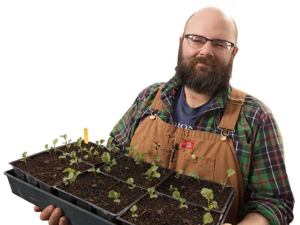 Mason Weaver of The Regional Food Bank of Oklahoma spends time in the organization's greenhouse to have plants ready for the spring. Photo by Brent Fuchs.