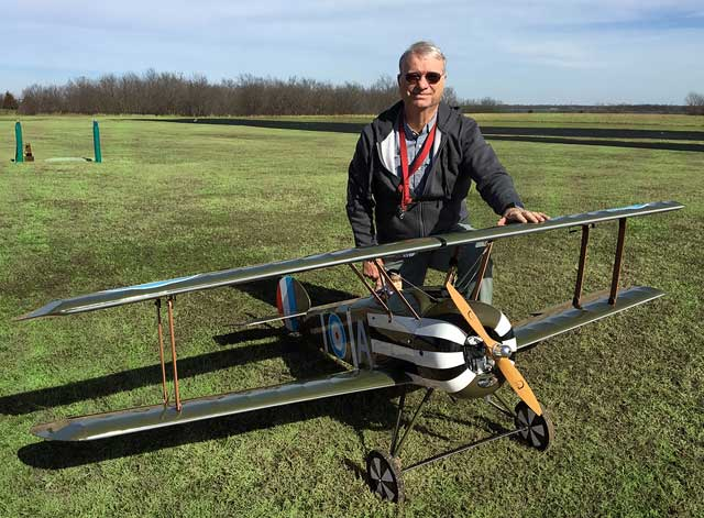 Retired teacher and coach Doug Bromley of the Tulsa Glue Dobbers readies his plane, the Sopwith Camel. Photo courtesy Mike Pennell.