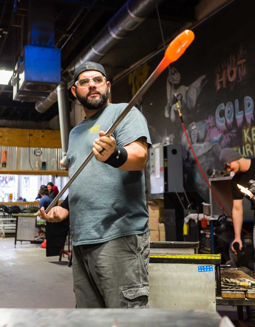 Kenneth Gonzalez learned glassblowing in college and now works to teach the art to students in Tulsa. Photo by Chris Humphrey Photographer.