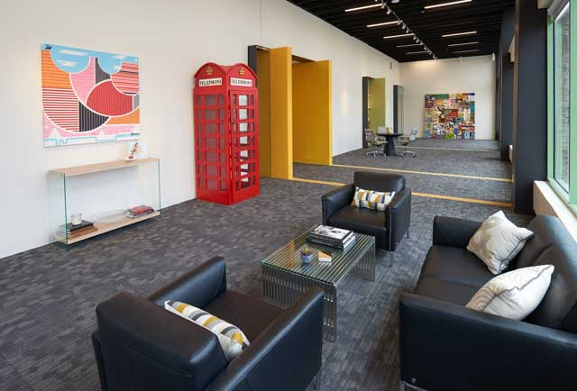 "London-style British red phone booth is a clever conversation piece in the TPC reception area. ""It was a prop from a fund-raising event we planned and we decided to give it a home in this area,"" Todd remarked."