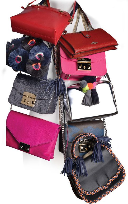 Clockwise from top: Furla ruby mini-bag, $208; Coach red cross-body mini-bag, $175; Furla hot pink mini-bag, $328; Rebecca Minkoff pom-pom silver mini-bag, $195; Furla camo-print mini-bag, $378; Rebecca Minkoff leather saddle bag, $295; Loeffler Randall hot pink suede cross-body, $350; Furla glitter.